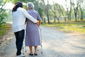 Help And Care Asian Senior Or Elderly Old Lady Woman Use Walker With Strong Health While Walking At  poster