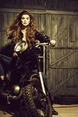 Biker, Girl Or Beautiful Woman With Blond, Long Hair In Leather Jacket Sitting On Vintage Motorcycle poster