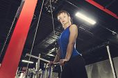 Classic Bodybuilding. Muscular Blonde Fitness Woman Doing Exercises In The Gym. Fitness - Concept Of poster