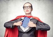 Attractive Young Business Lady In Red Hero Cape On Grey Wall Background. Portrait Of Business Woman  poster