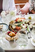 Wedding Table Setting. Festive Table With White Tablecloth. Guests Sit At The Table. On The Table Ar poster