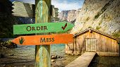 Street Sign The Direction Way To Order Versus Mess poster
