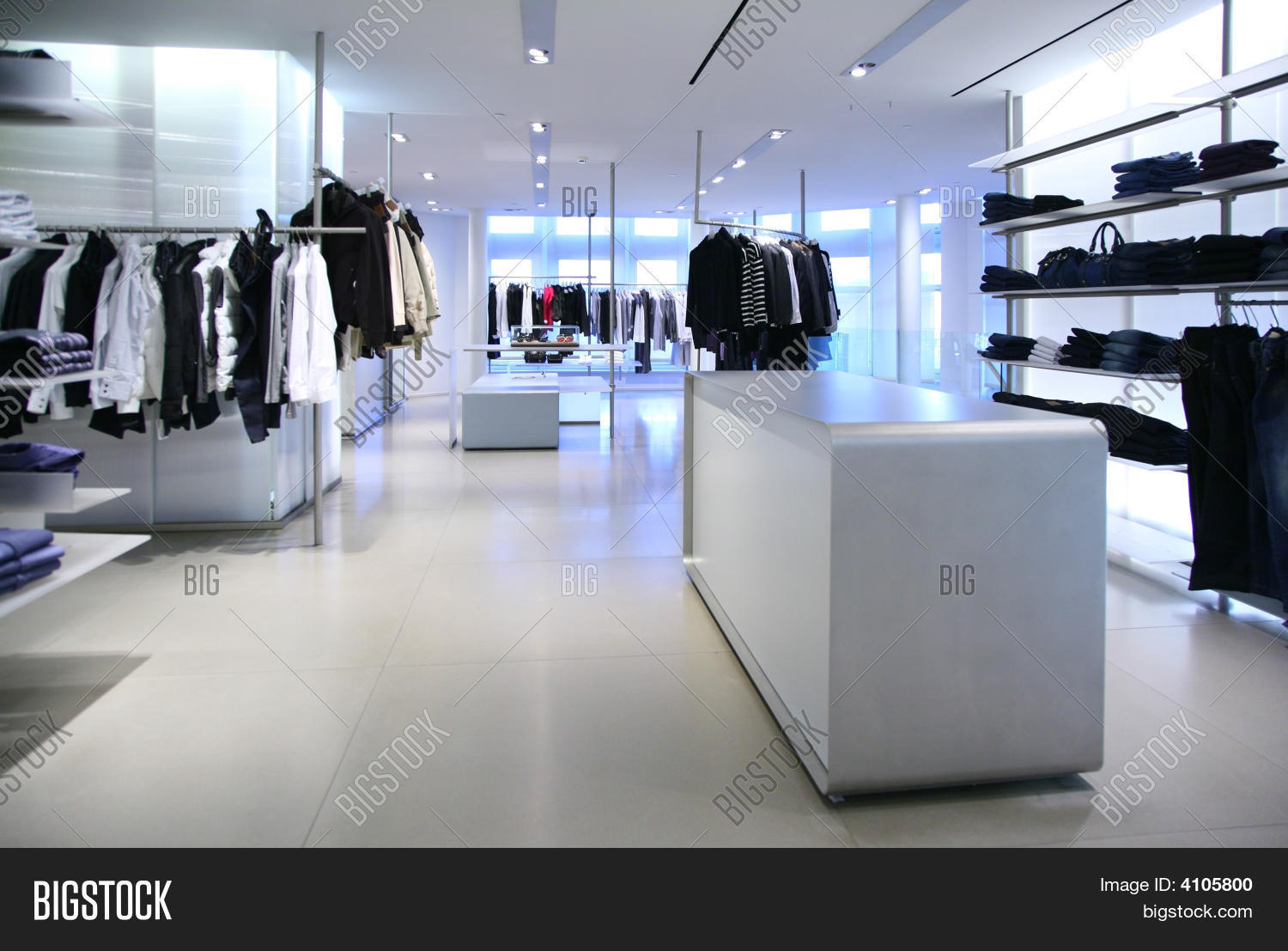 clothing in a empty modern store stock photo  stock images  bigstock - clothing in a empty modern store