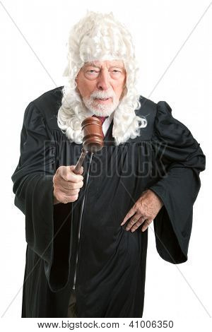 Firm, angry British style judge with white wig, waving his gavel.  Isolated on white.