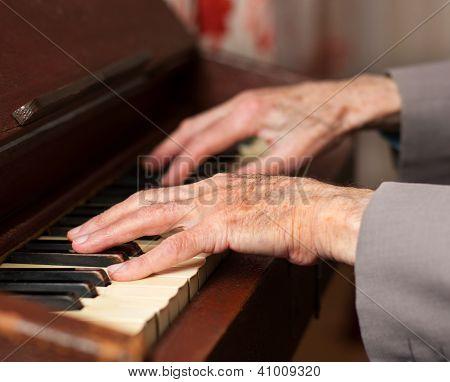 Hands Playing A Harmonium