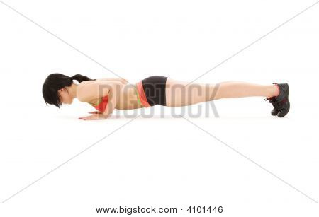 Woman Practicing Four-Limbed Staff Pose
