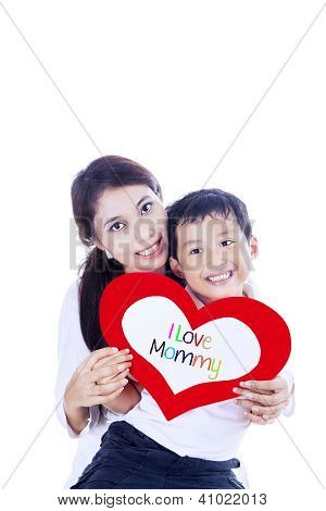 Cheerful Boy Gives Love Card To Mother