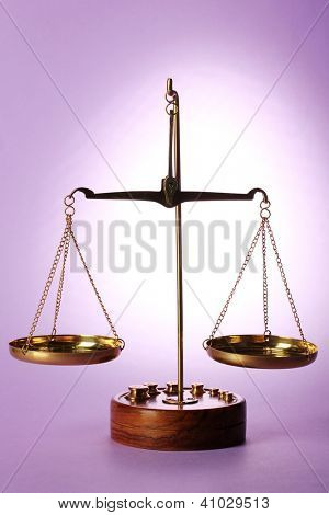Classic scales on purple background