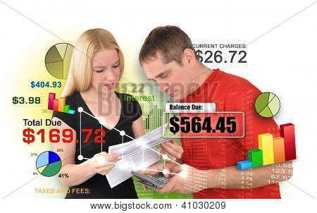 Finance Couple Reviewing Bills On White