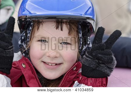 Happy girl in blue helmet