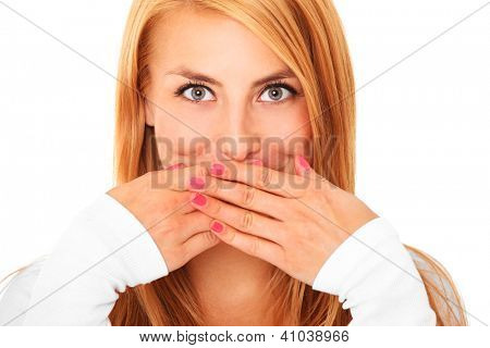 A picture of a young beautiful woman covering her lips with hands over white background