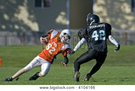 Youth Football Trying To Avoid Tackle
