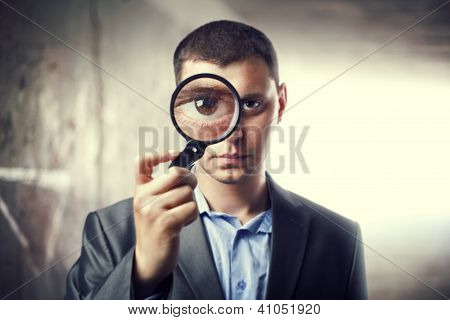 Detective Looking Through Magnifying Glass In Subway Tunnel. Light At End Of Tunnel