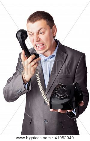 An Angry Businessman Screaming In Telephone Receiver Isolated On White Background