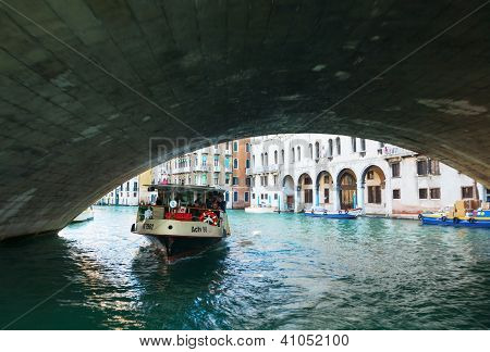 Vaporetto With Tourists Under Rialto Bridge (ponte Di Rialto)