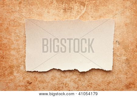 Ripped Piece Of Paper On Grunge Paper Background. Vintage Retro Card