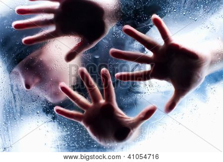 Silhouettes Of Person Behind Wet Glass. Freeze To Death