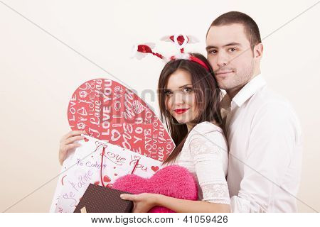 Couple in love on valentines day while girl is holding presents