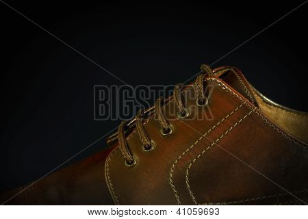 Close-up Of A Brown Shoe On Black
