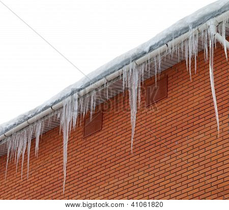 Snow-covered Roof With Icicles On White Background