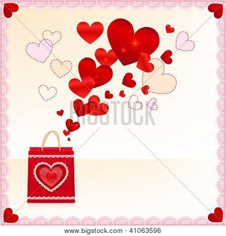 Sacola de papel vermelho com corações que voam