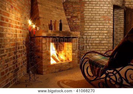 Rocking Chair By The Fireplace And With Candles