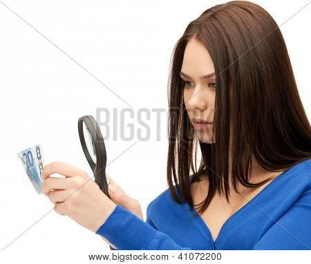 beautiful woman with magnifying glass and euro cash money..