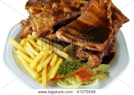 Spareribs And Fries On White Plate Close Up