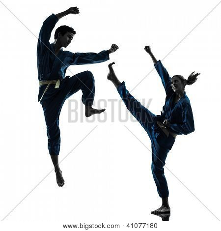 one caucasian man woman couple exercising karate vietvodao martial arts in silhouette studio isolated on white background