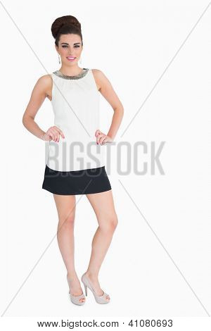 Woman posing in mod style on white background