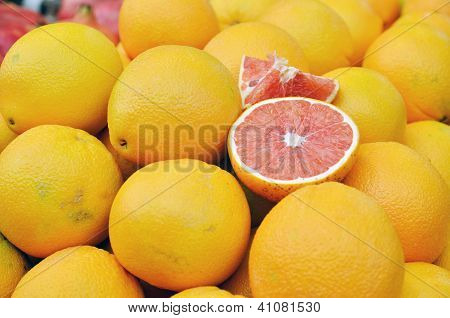 Red Grapefruit On Market Stand