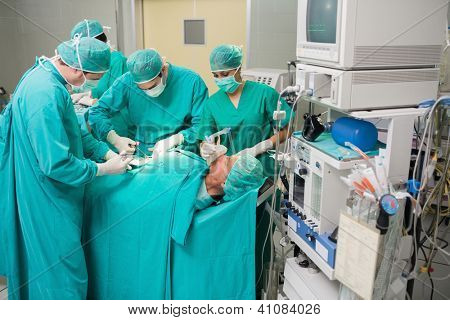 View of a medical team operating in an operating theatre