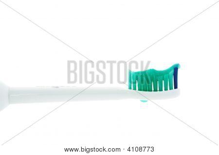 Cabeça da escova de dentes com Toothpast do lado