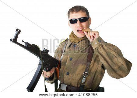 Soldier Wearing Sunglasses With Machine Gun Smoking A Cigar