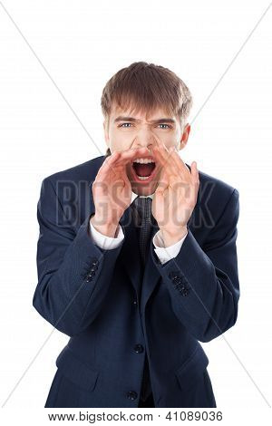 Young Businessman Shouting Through Hands Isolated On White Background