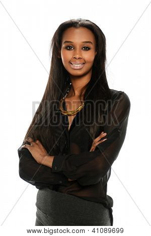 Young black  Businesswoman smiling and with her arms crossed