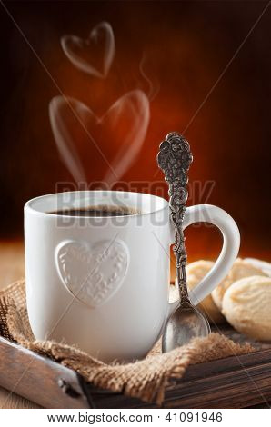 Valentine's day coffee and biscuits with focus on decorative antique spoon