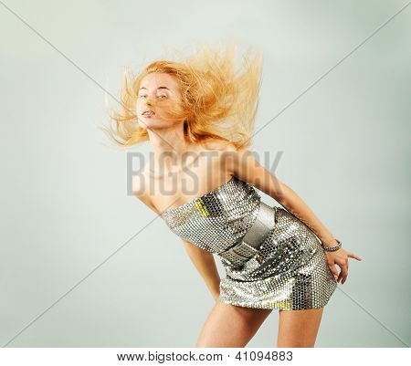 Dancing Woman in Silver Dress. Fashion Photo