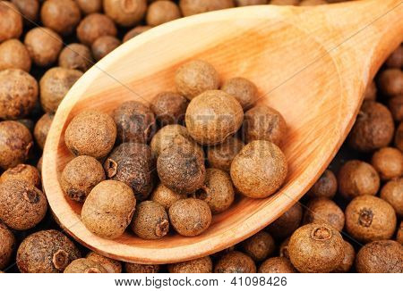 Background Texture Of Whole Allspice(jamaica Pepper) With Wooden Spoon Used As A Spice In Cuisines A