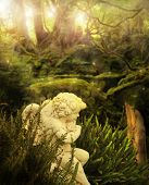 stock photo of cherub  - Classical cherub angel in mystical garden setting with rays of light streaming above - JPG