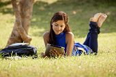 stock photo of exams  - Students and education young people at school woman with books and digital tablet computer studying for university exam - JPG