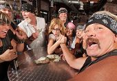 stock photo of wrestling  - Tough man reacting in arm wrestling match with female nerd - JPG