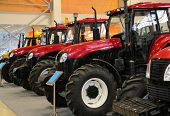 picture of workhorses  - Many new Tractors on the exhibition agriculture - JPG