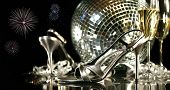 stock photo of christmas party  - Silver party shoes with champagne glasses against a festive background - JPG