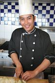 Chef Cooking And Smiling poster