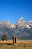 picture of outhouses  - This majestic landscape features rugged mountains in Grand Teton National Park towering above the prairie in a quintessential American West landscape - JPG
