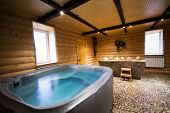 stock photo of hot-tub  - Bath with water in a beautiful wooden sauna - JPG