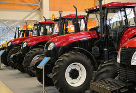 stock photo of workhorses  - Many new Tractors on the exhibition agriculture - JPG