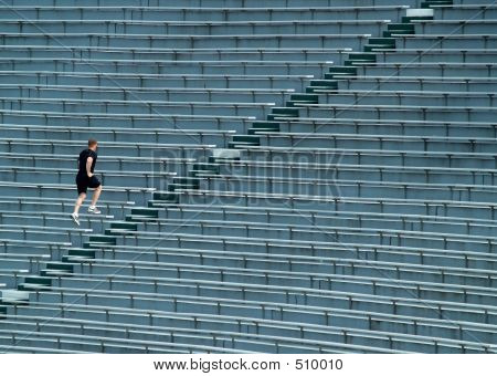 Man Running Bleachers
