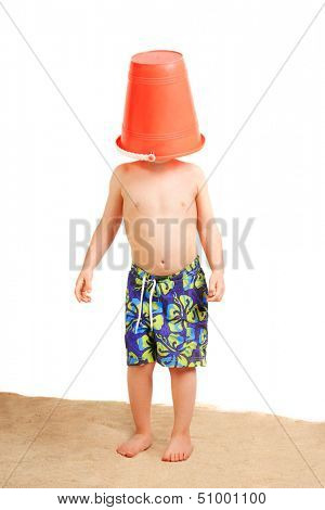 Young boy with a bucket on his head